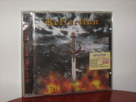 Reflection - The Fire Still Burns