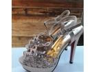 Zlatne elegantne sandale na stiklu