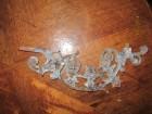 metalni ukras verovatno za ogradu i metalna zakačaljka